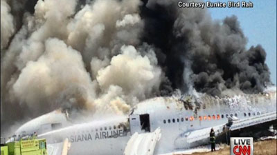 Smoke billows from the Boeing 777 after it crash landed on July 6. Photo courtesy: CNN.