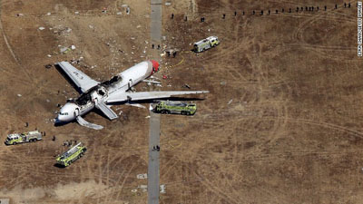 Scene of the crash. Emergency vehicles surround the burned hulk of Asiana Airlines Flight 214 from South Korea that crashed upon landing Saturday at San Francisco's airport. Photo courtesy: CNN.