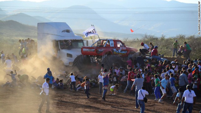 People run as an out of control monster truck plows through a crowd of spectators at a Mexican air show in the city of Chihuahua, Mexico, Saturday Oct. 5, 2013. According to authorities, at least 8 people were killed and 80 were injured. Photo courtesy: CNN.