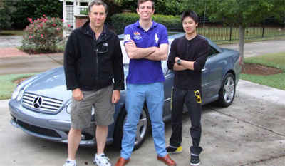 Dave Black, Ed Bolian and Dan Huang pose in front of the car they would use to attempt to break the record. Bolian is the leader and main driver, Black acted as the co-driver and Huang was the team's spotter -- keeping an eye on the car's considerable technology while looking out for obstacles. Photo courtesy: CNN.