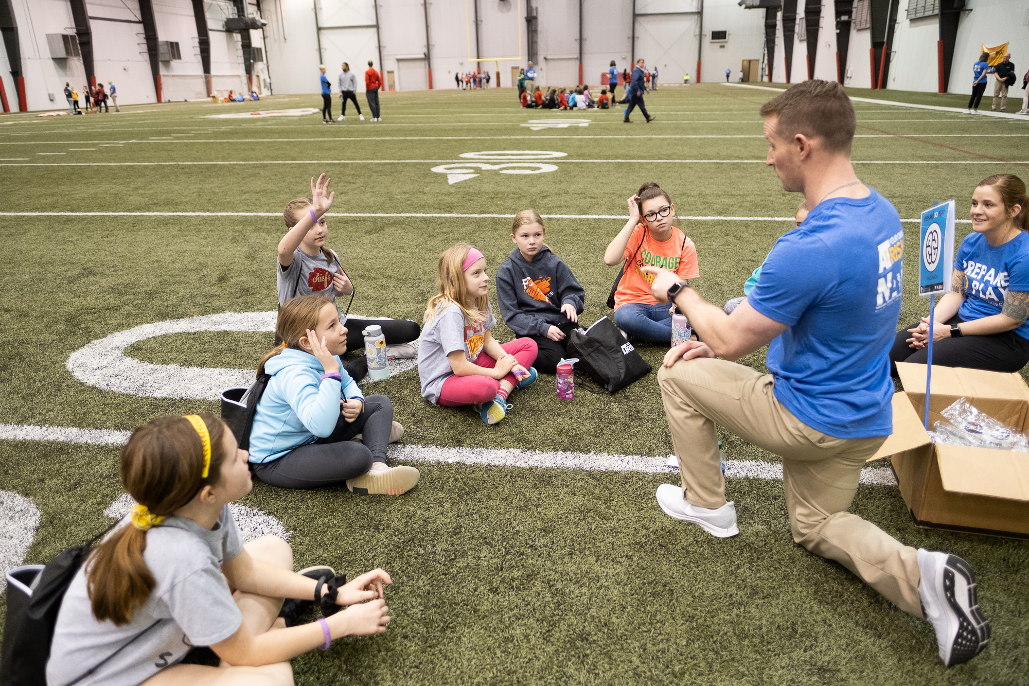 Picture of kids sitting on the turf
