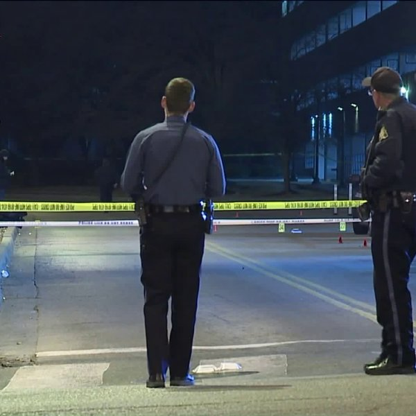 Police stand at a crime scene in Westport