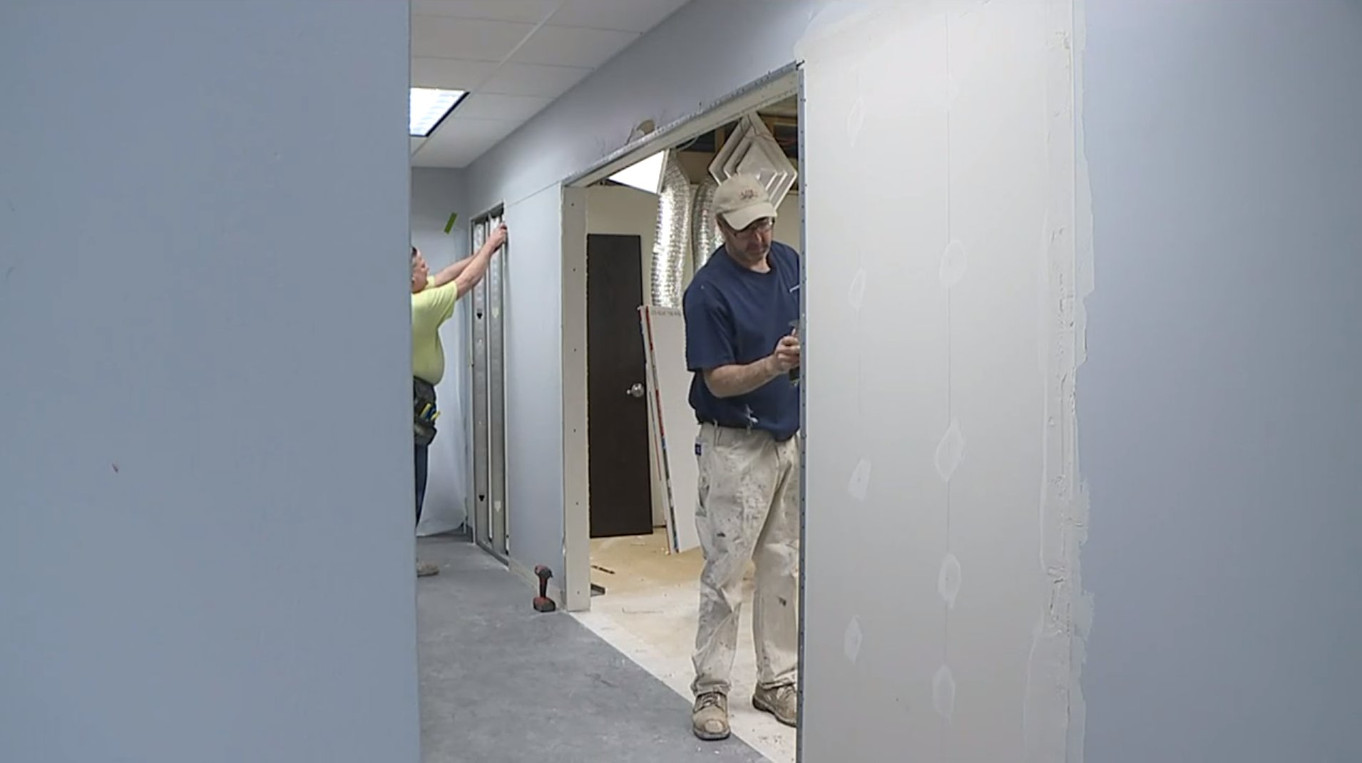 Picture of a man working on dry wall