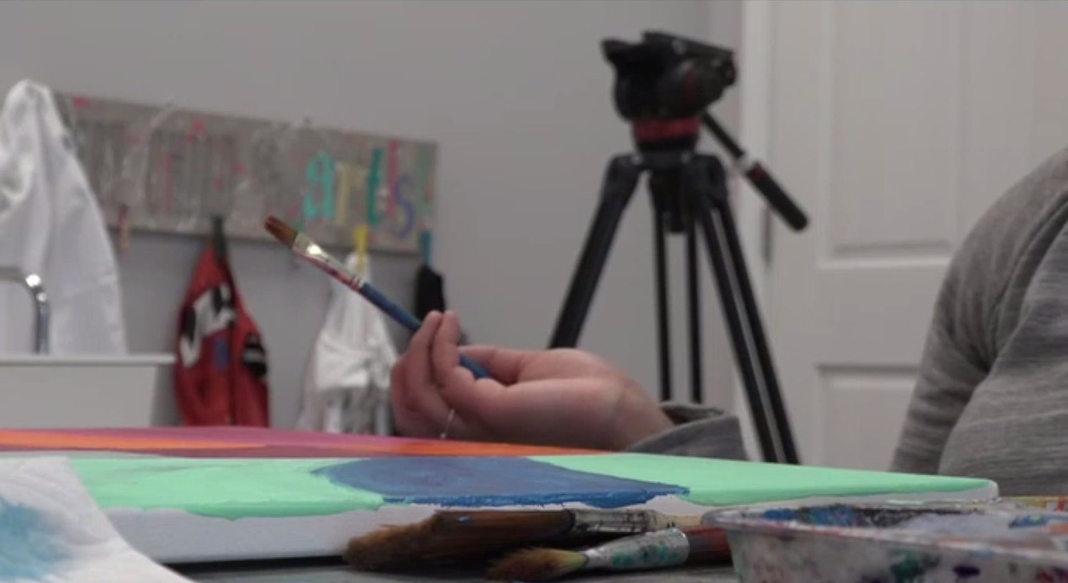 Picture of girl holding a paintbrush