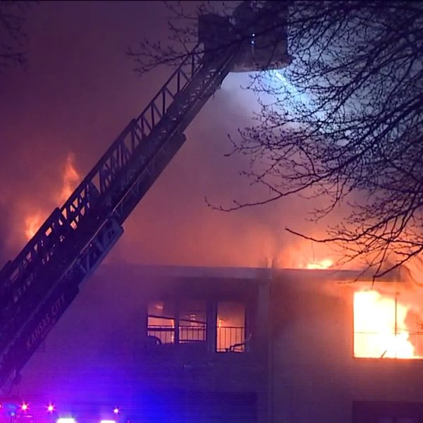 Crews attempting to put out a big fire at an apartment complex