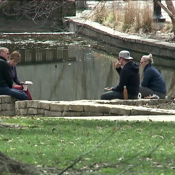 People enjoying spring day at Loose Park