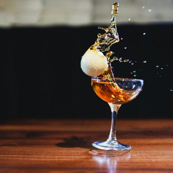 Picture of a golf ball and a cocktail