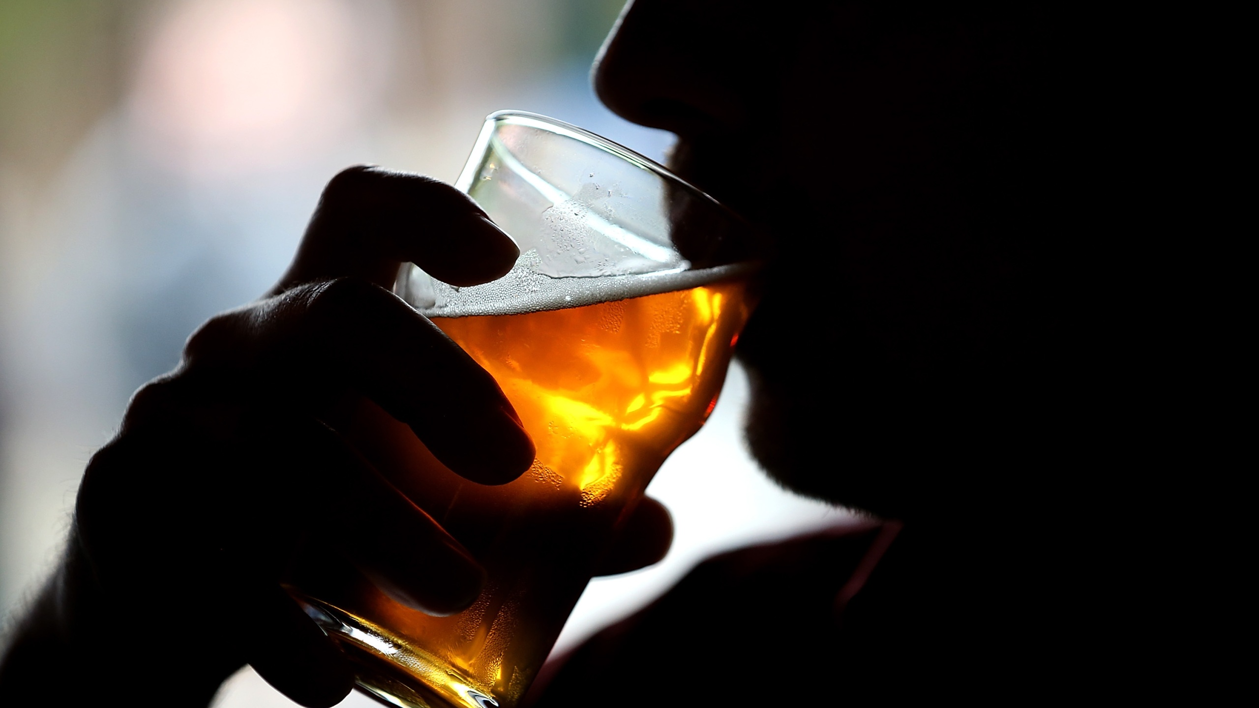Picture of silhouette drinking beer