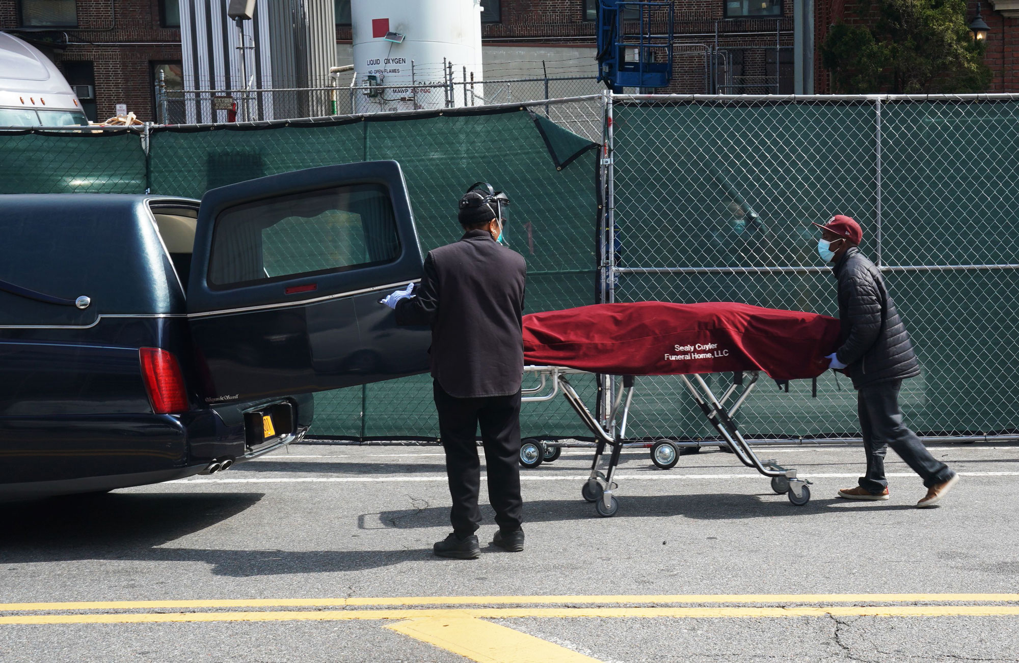 Picture of body going into a hearse