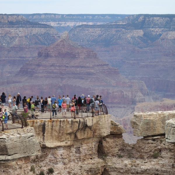People standing at overlook at the Grand Canyon