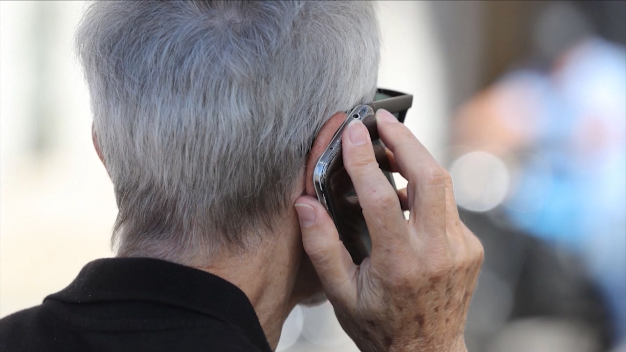 Picture of older person on phone