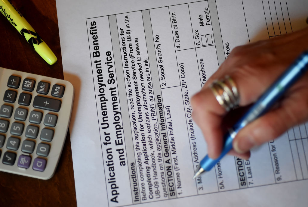 Picture of person filling out unemployment form