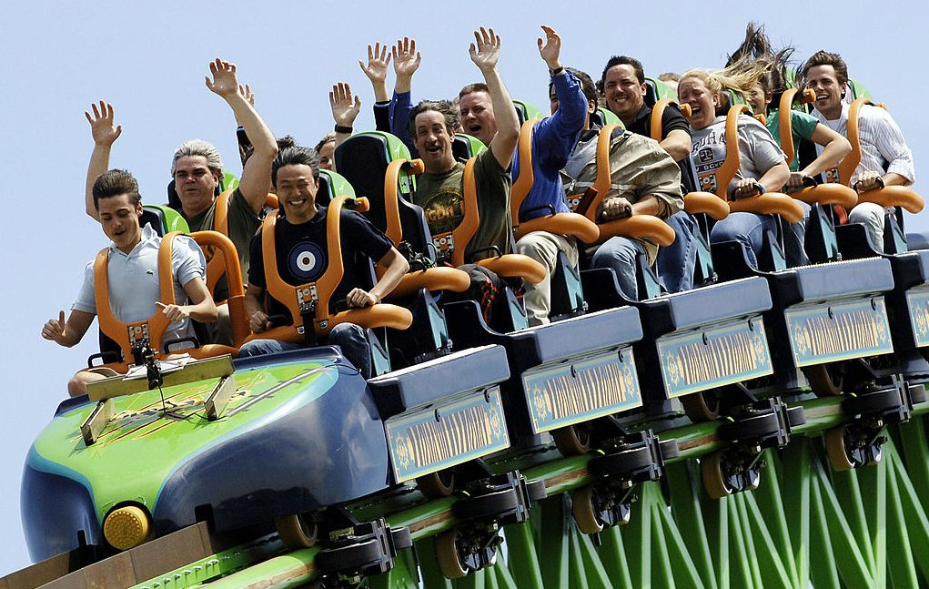 Picture of riders on a roller coaster