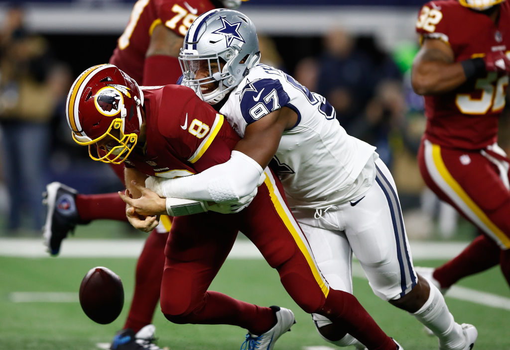 Picture of Taco Charlton tackling Kirk Cousins