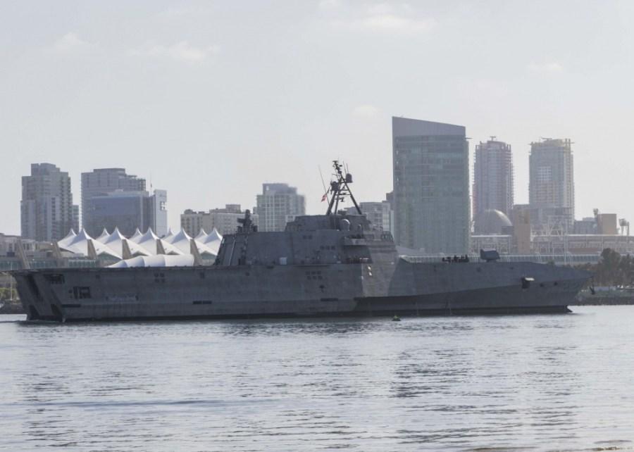 Picture of USS Kansas City against San Diego skyline