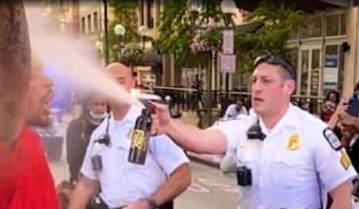Picture of police spraying pepper spray