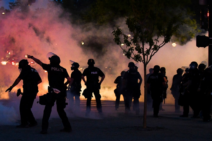 Picture of police firing tear gas