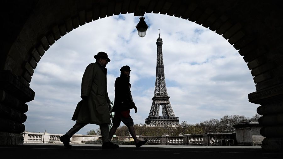 Picture of people walking with Eiffel tower in background