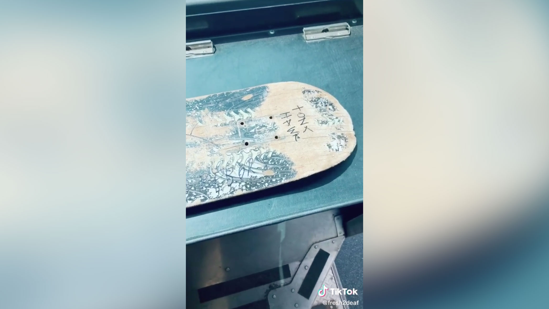 Picture of skateboard with Tony Hawk written on it