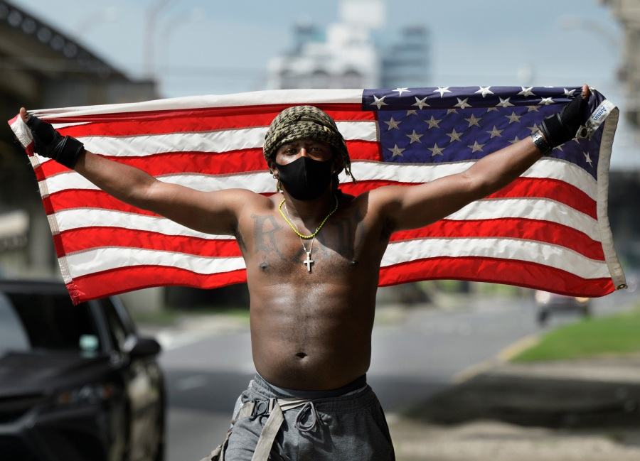 A protester holds up an American flag
