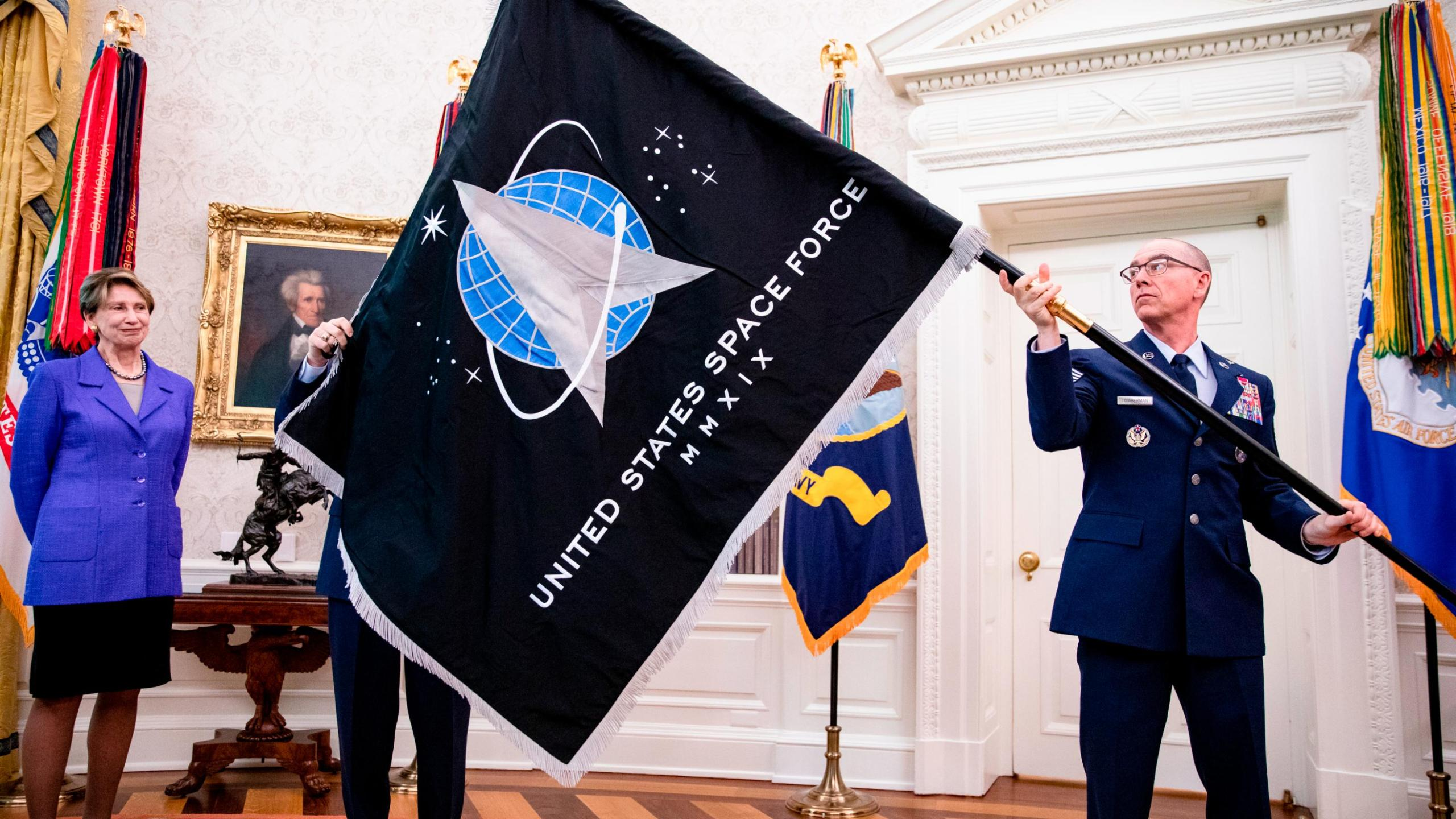Picture of man holding Space Force flag