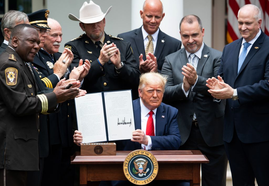 Picture of Trump holding up police executive order