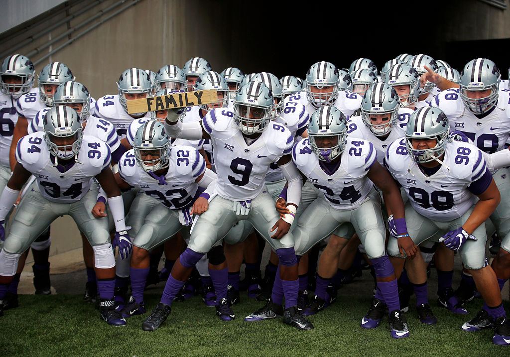 "Picture of Kansas State football team holding ""family"" sign"
