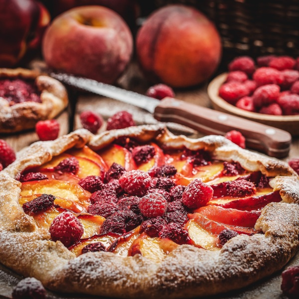Rustic open pie with peach and raspberry picture