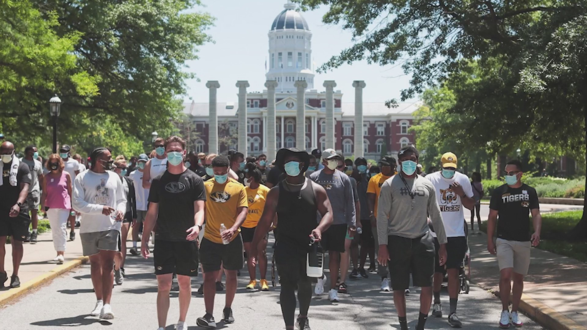 Picture of Mizzou football players marching