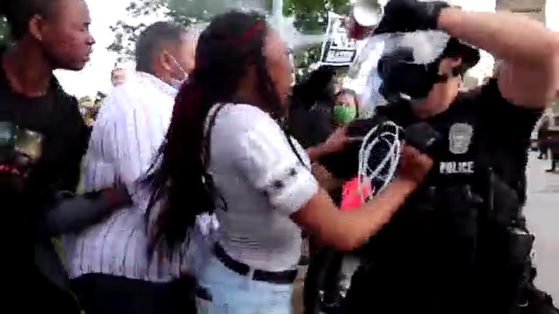 Picture of girl getting pepper sprayed in Kansas City
