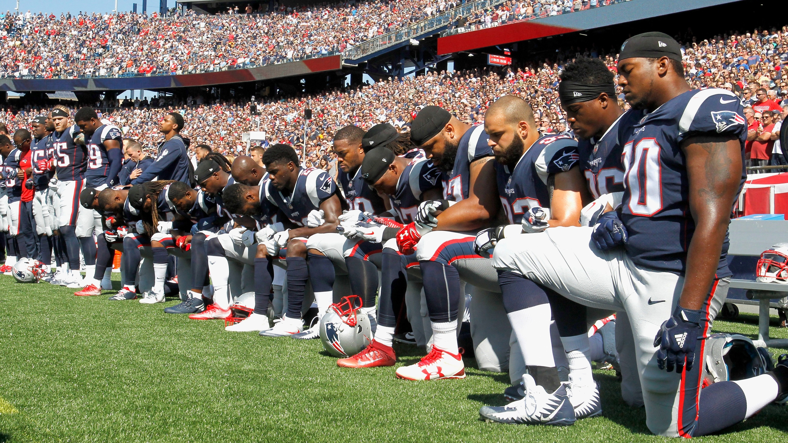 Picture of NFL players kneeling