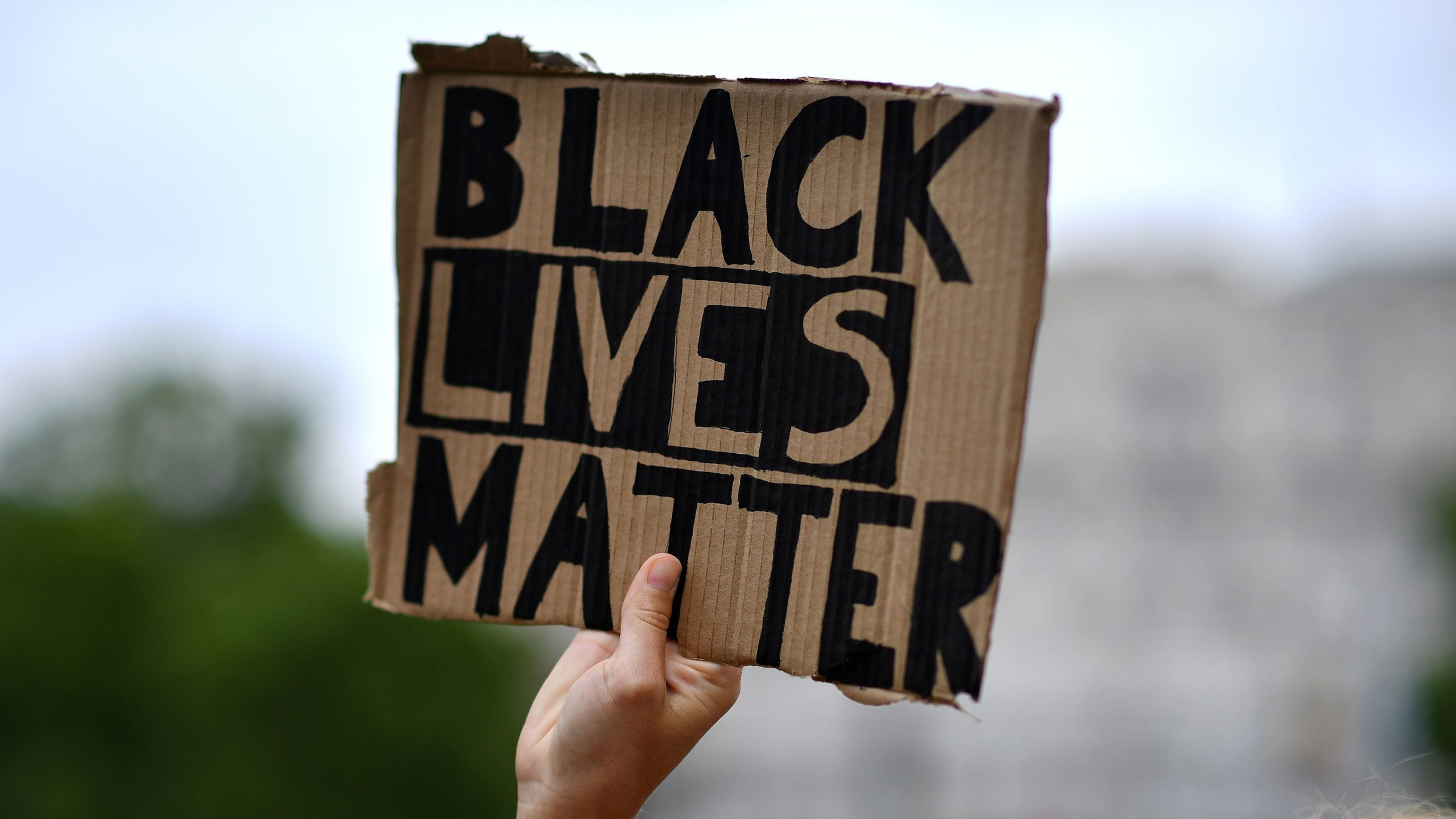 Picture of hand holding Black Lives Matter sign