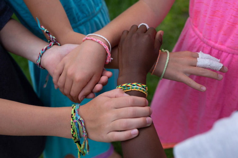 Picture of wrists with bracelets on them
