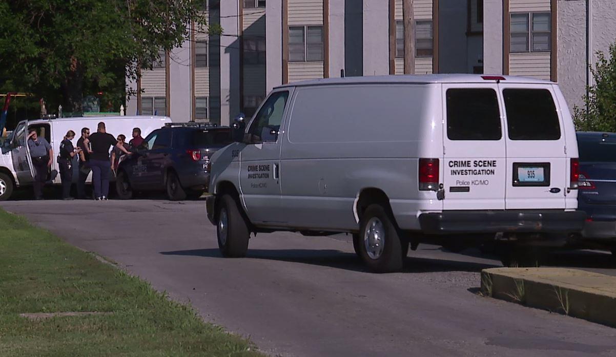 Crime scene investigators at Cloverleaf Apartments