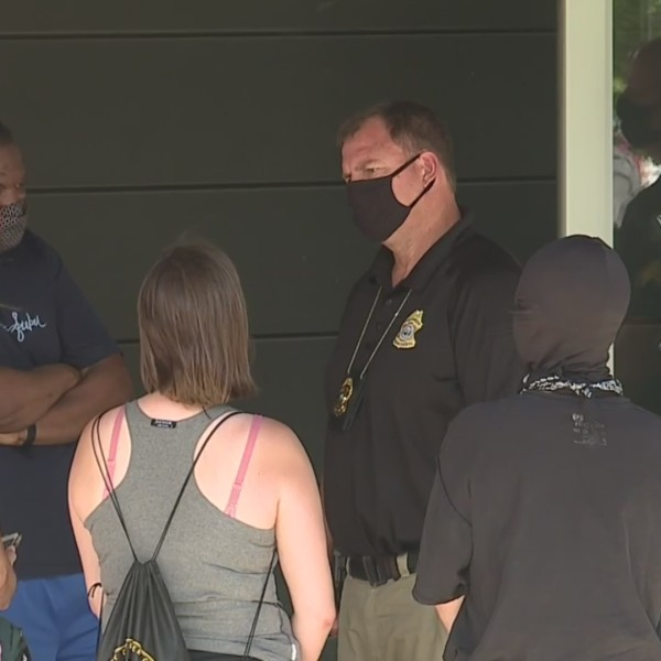 Picture of protesters face to face with Overland Park police