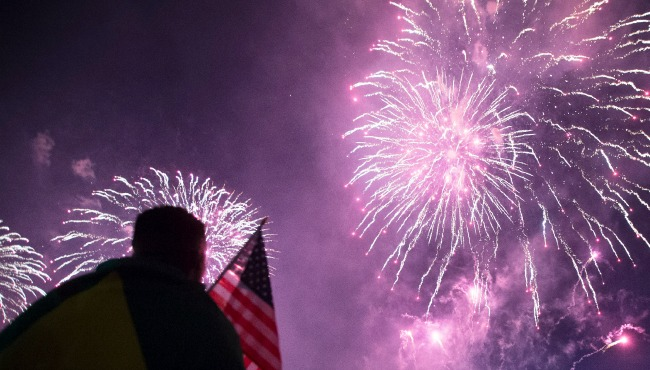 Picture of silhouette, flag and fireworks