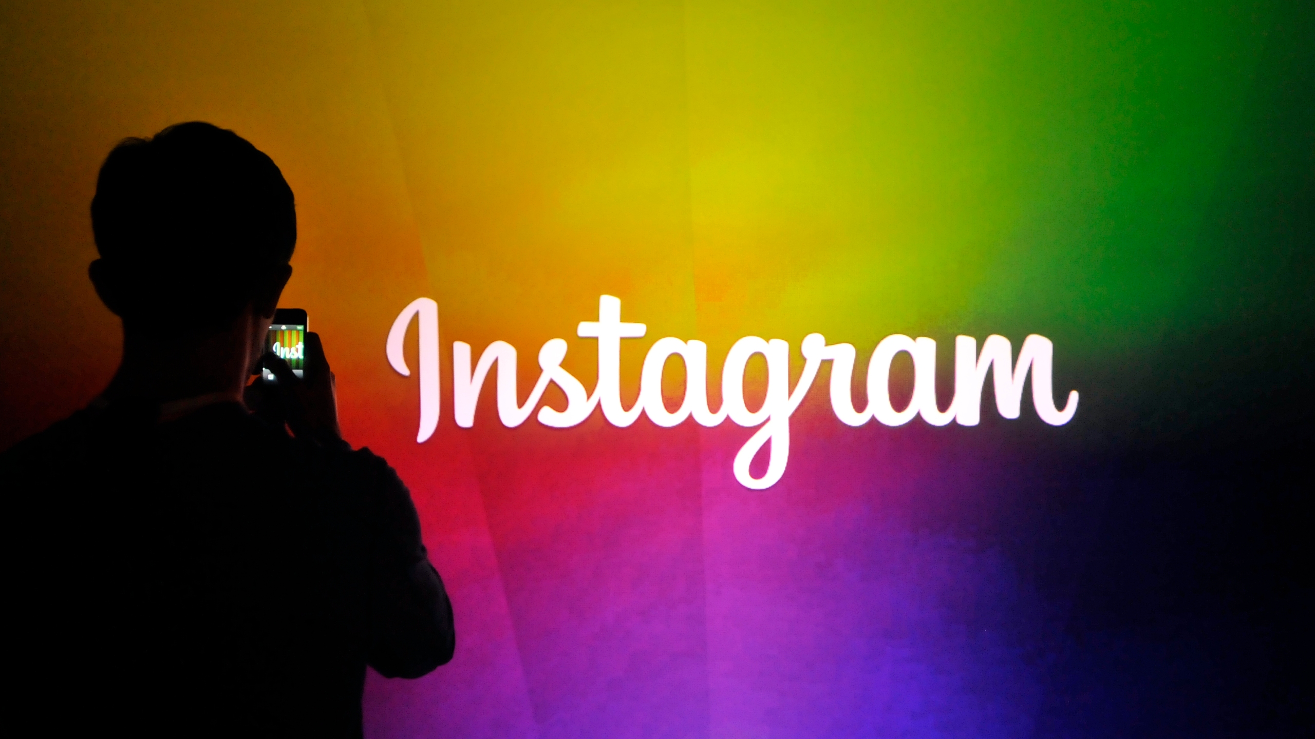 Picture of silhouette in front of Instagram sign
