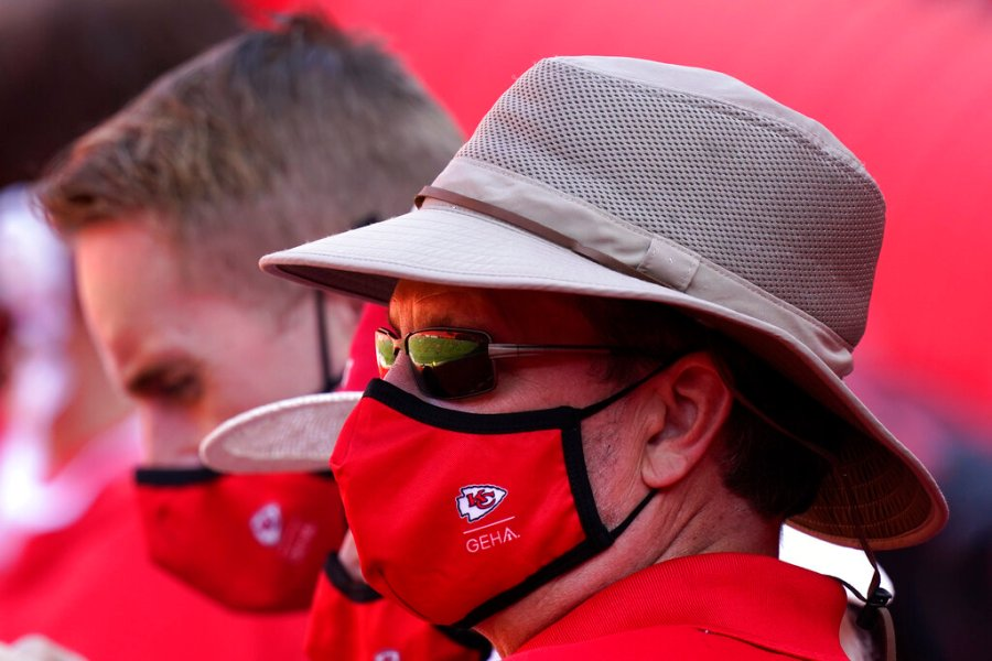Fans wearing face masks watch the Kansas City Chiefs