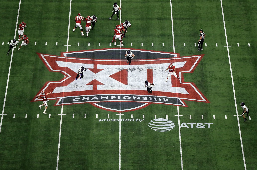 Picture of players on field with Big 12 logo