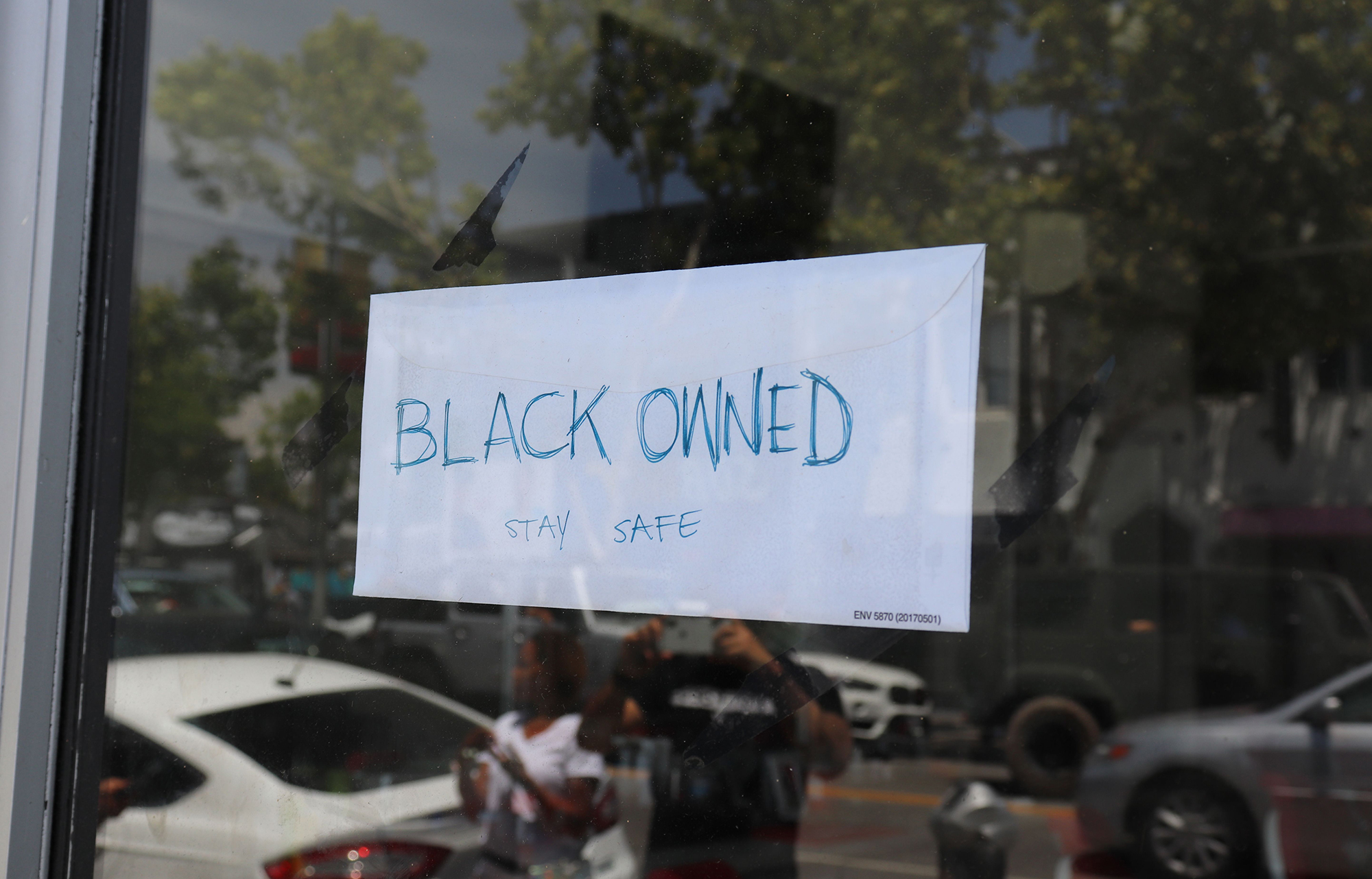 "Picture of sign stating ""BLACK OWNED"""
