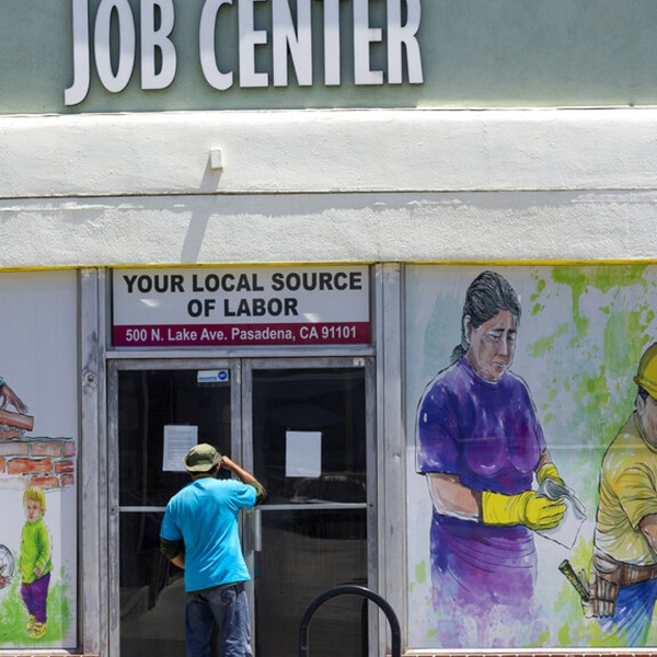 Picture of person looking into job center window