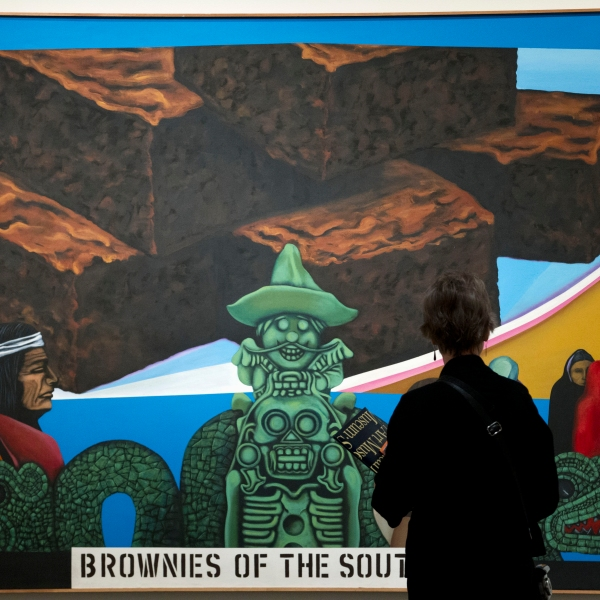 Picture of people looking at a Latino-themed painting