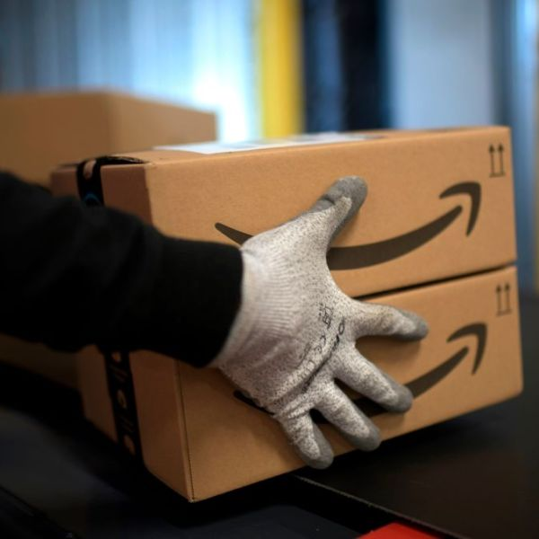Picture of Amazon worker holding boxes