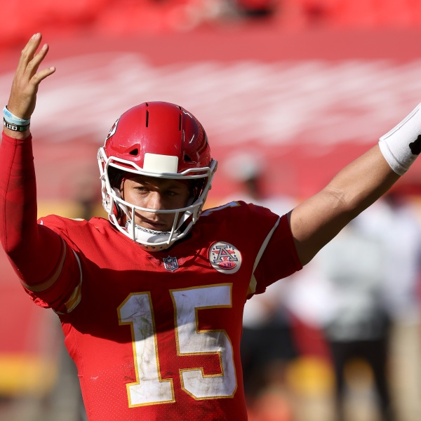 Picture of Mahomes with his hands raised