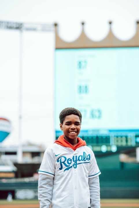 Picture of Terkese in front of crown big board