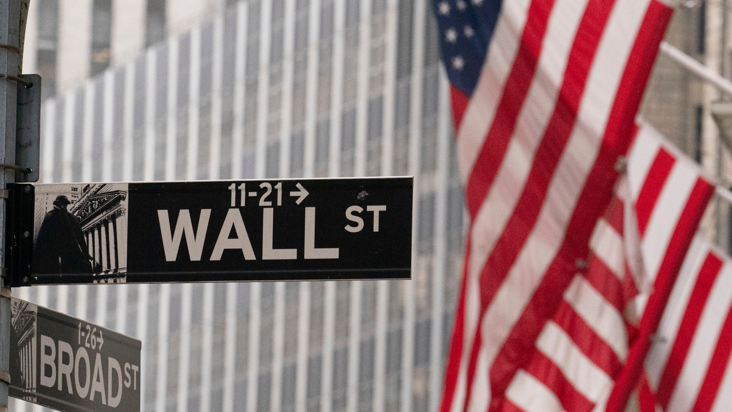 Picture of flag with Wall Street sign
