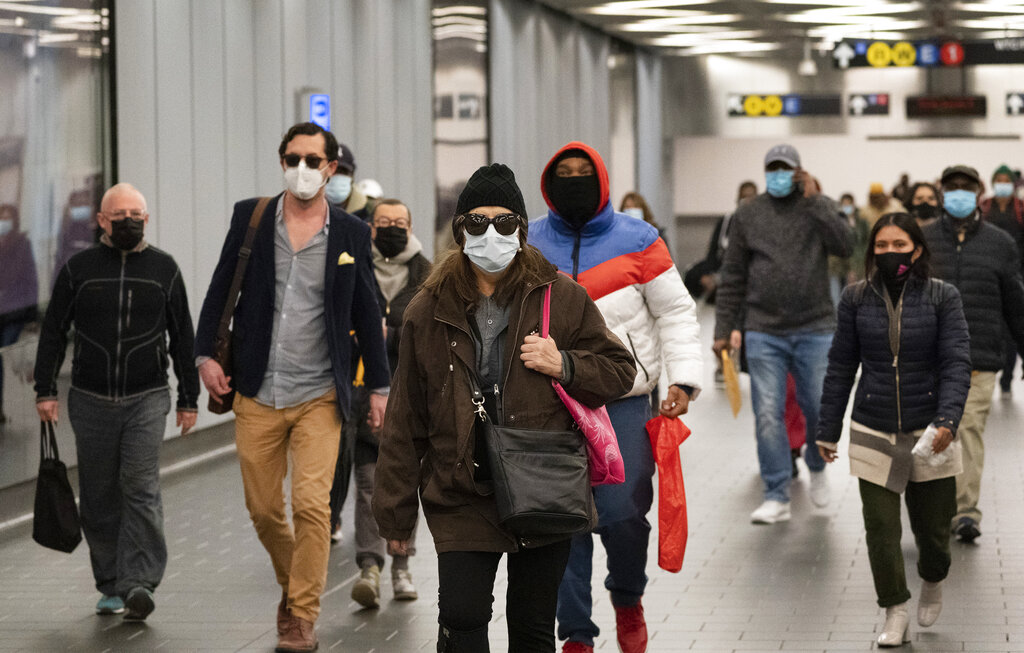 Picture of people walking in masks