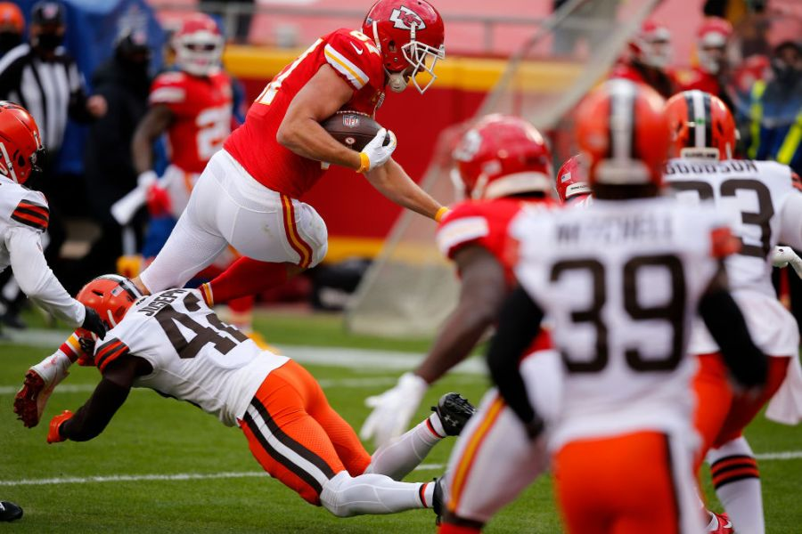 Picture of Kelce leaping into the endzone