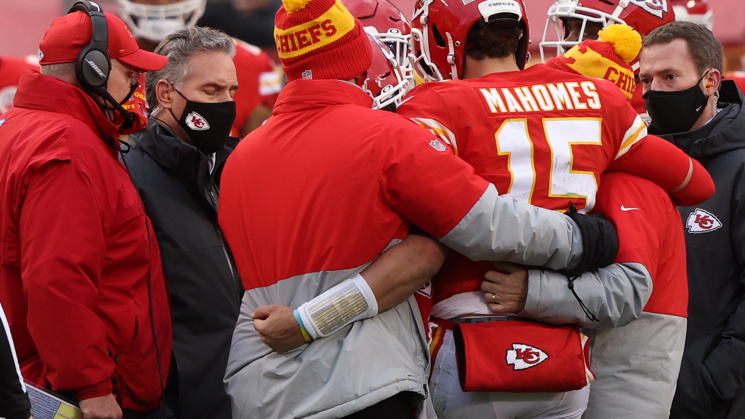 Mahomes walking off the field assisted