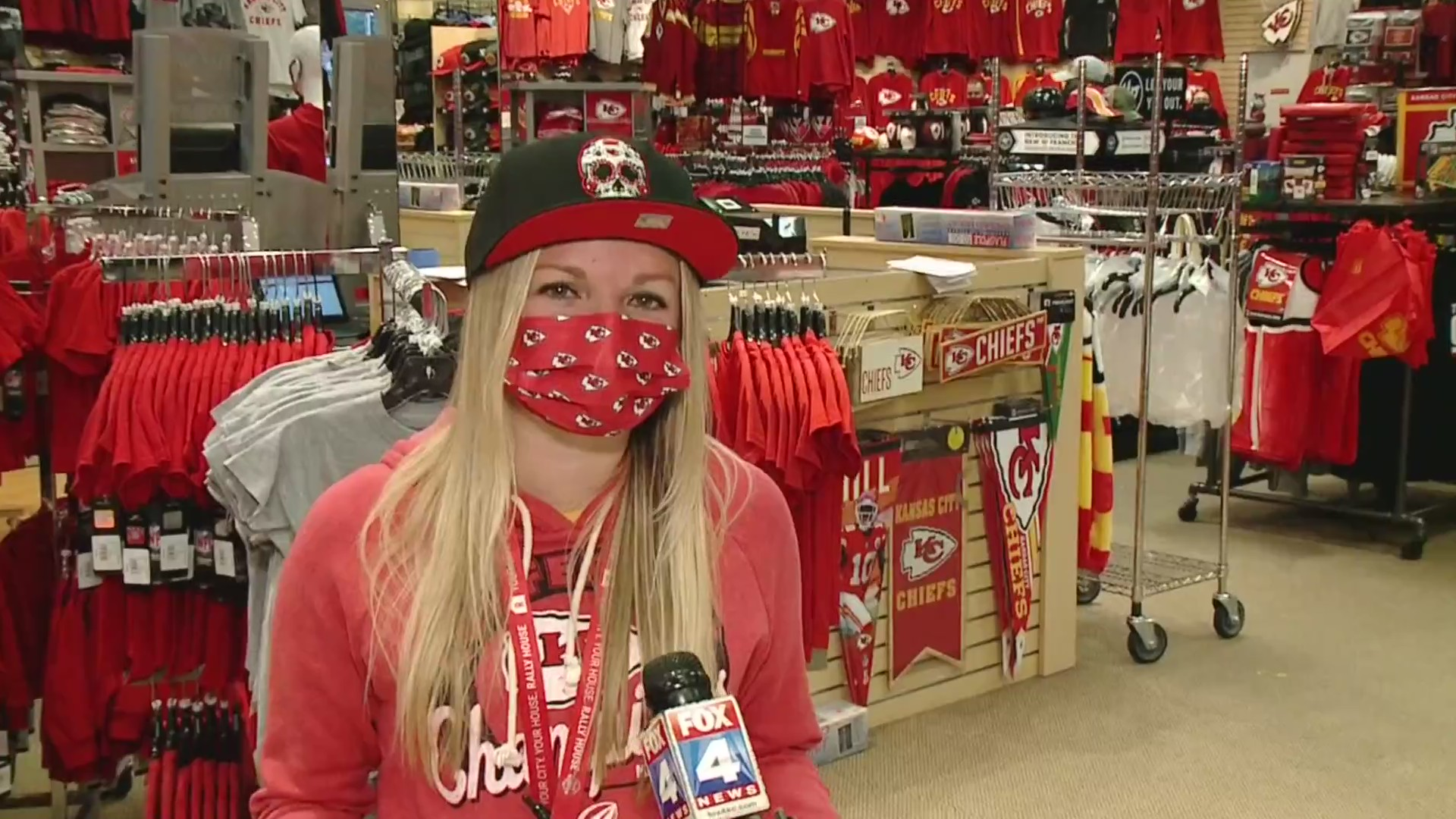 Picture of woman in Chiefs gear at apparel store